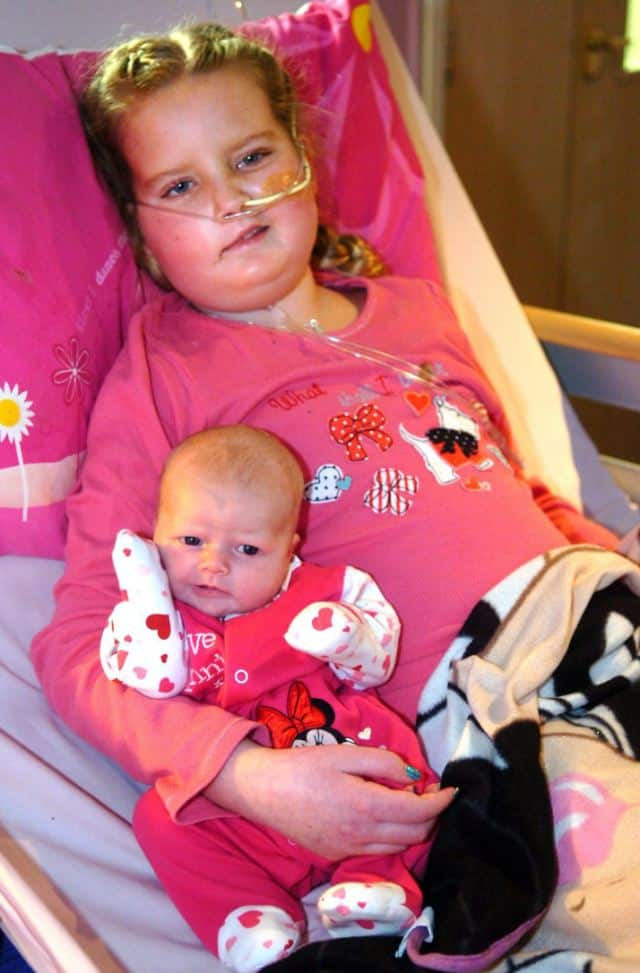 mother induces labor so baby can meet sister