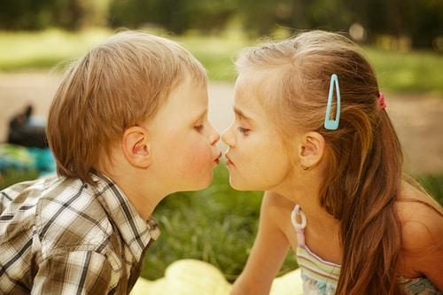 children kissing