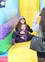 """""""Modern Family"""" star Ariel Winter enjoys an inflatable slide with her niece Skylar, at a farmers market in Los Angeles"""