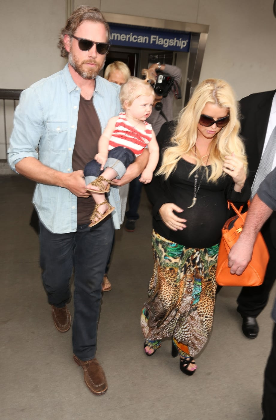 Pregnant Jessica Simpson makes her way through LAX with fiance Eric Johnson and their baby daughter Maxwell in Los Angeles