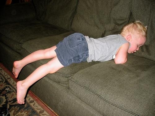 boy asleep on sofa