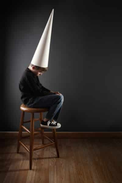 child with dunce cap