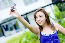 girl-taking-picture-with-phone