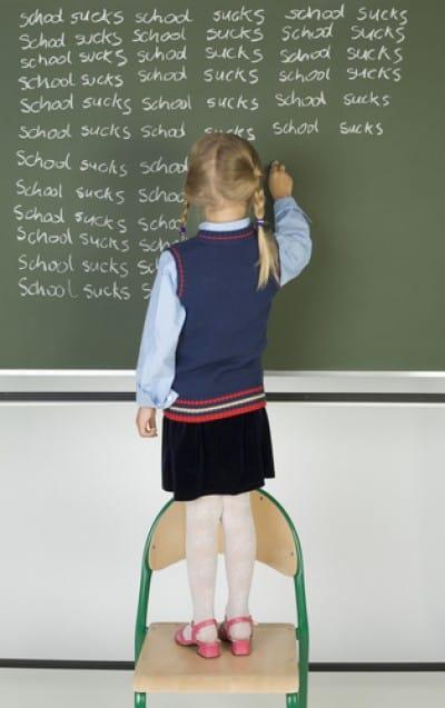 girl writing on chalk board