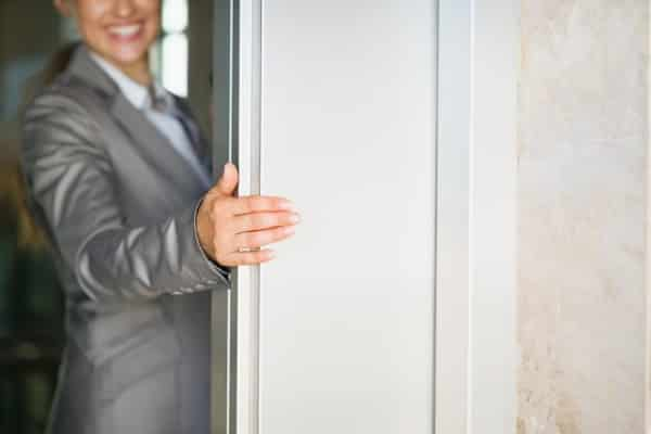 woman opening elevator