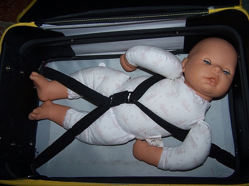 baby doll in suitcase