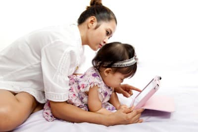 mom with baby and tablet