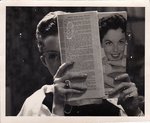 1950s woman reading magazine