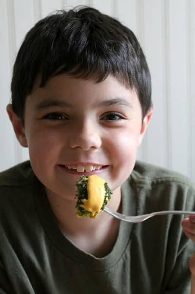 boy with cheese brocoli