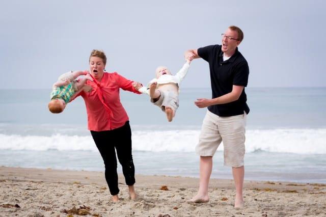 awkward family photo baby falling