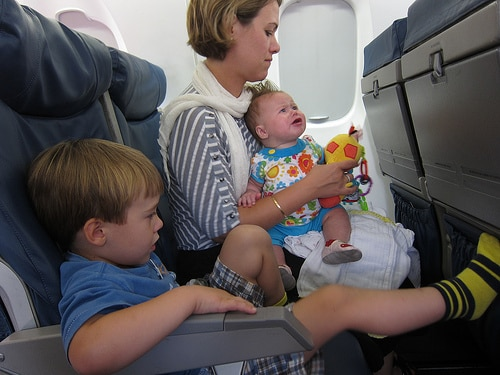 mother and kids on plane