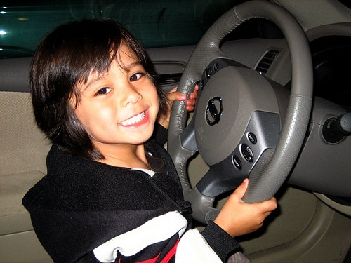 toddler at steering wheel