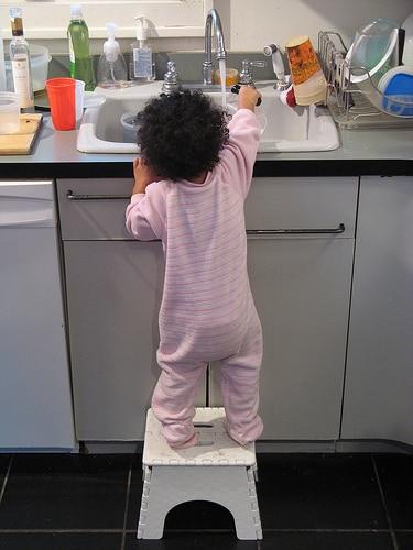 toddler washing dish