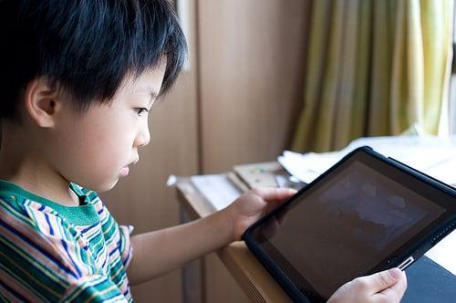 a kid with iPad