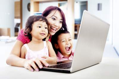 mom on computer with kids
