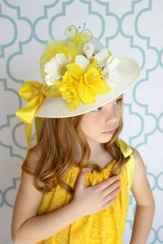 Girls Hats Blue Gold Easter Hat Child ages 4 to 10 Silk Flowers Bag. $ Buy It Now. Free Shipping. The Hat ribbons are a gold satin ribbon and Gold lace ribbon with a two stand of gold rhinestone around the rim with Gold Faux flowers. This is for a children size Blue and Gold Easter Hat. (vase not.