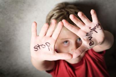 Boy with stop bullying on hands