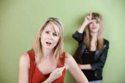 annoyed mom with woman saying loser