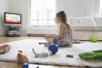 girl watching tv in her room