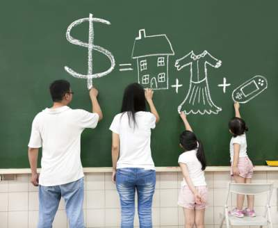 parents writing about money on chalkboard