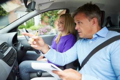 stressed dad giving driving lesson