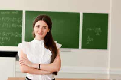 teacher in front of chalk board