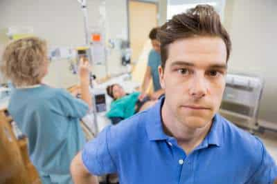 worried father in delivery room