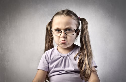 Angry only child with glasses