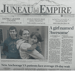 The front page of the Empire through the window of the newspaper box, taken at a funny angle because I was riding a wave of joy and surprise at seeing my kids' happy faces on the front page of the paper. Plus, I'm not always so great with the camera phone.