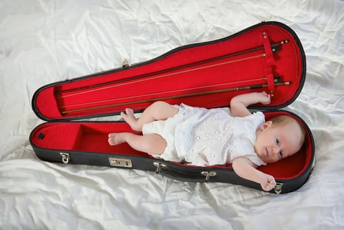 baby in violin case