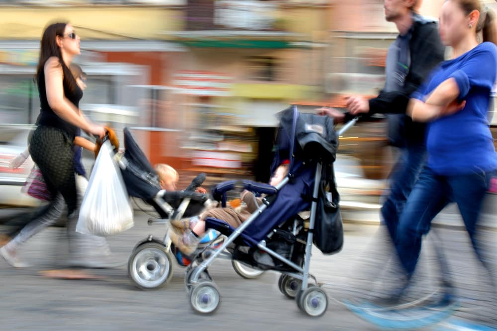 pushing-child-in-stroller