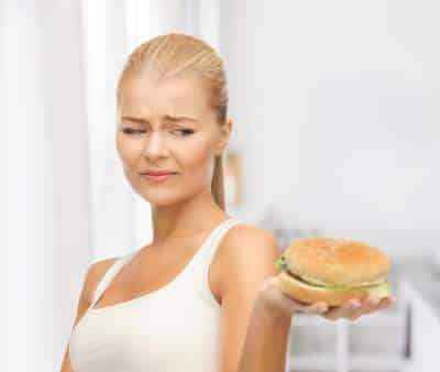 woman disgusted by burger