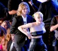 Miley's Latest Publicity Stunt Uses Cute Homeless Guy Instead Of Foam Finger