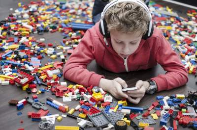 spoiled child surrounded by LEGOs