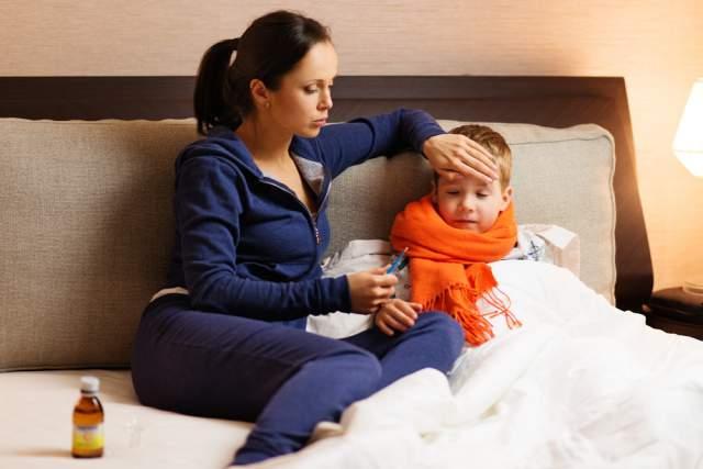 Mom-taking-temperature-sick-kid