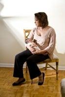 sad-mom-holding-infant