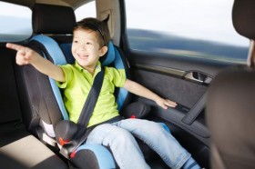 happy child in car seat