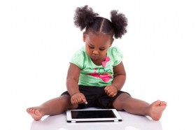 toddler-girl-reading-ipad