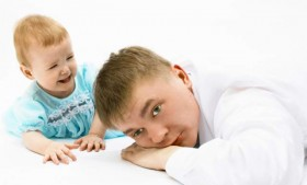 bored dad with baby
