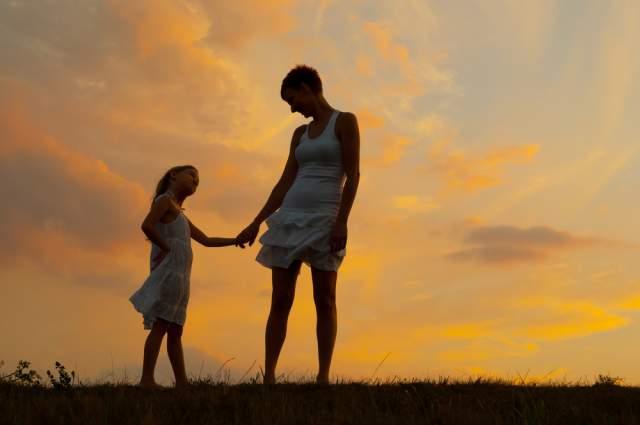 mom daughter sunset