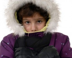 shivering child in parka and gloves