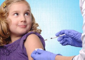little girl getting vaccinated
