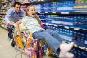 girl pushed on shopping cart