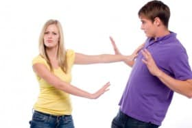 girl pushing boy away