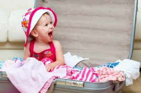 laughing-baby-in-suitcase