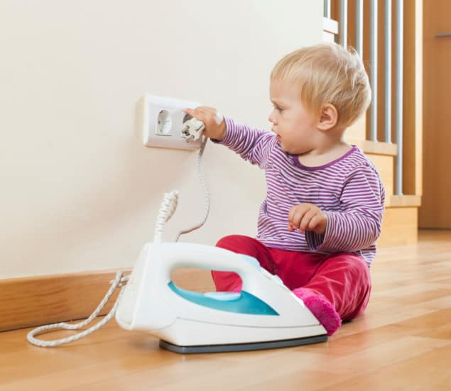 baby-playing-with-electric-iron
