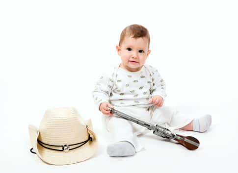 baby-playing-with-gun