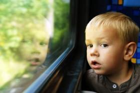 little-boy-looking-out-window