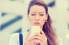 upset-woman-holding-cell-phone