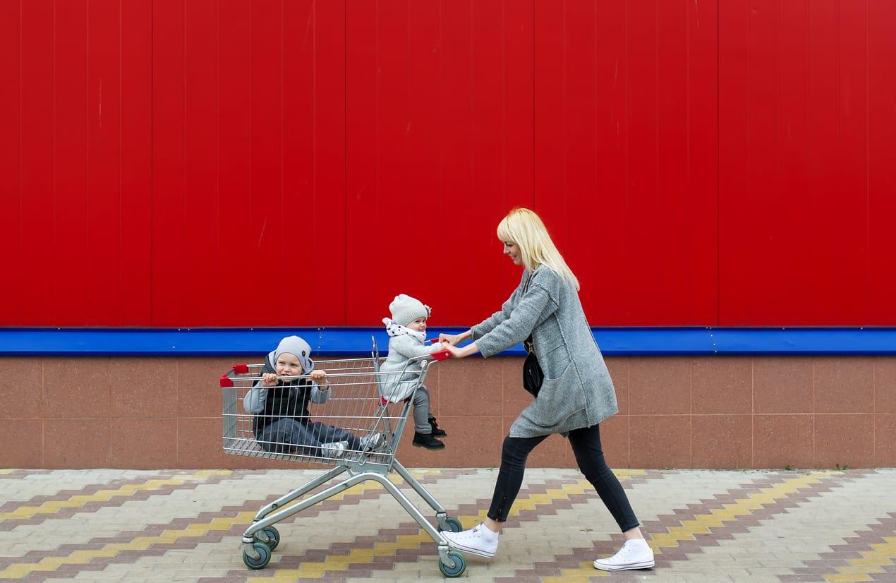 Mother rolls in the cart of children.